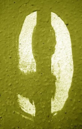 Number 9 in stencil on metal wall in yellow tone. Abstract background and texture for design. Stock fotó