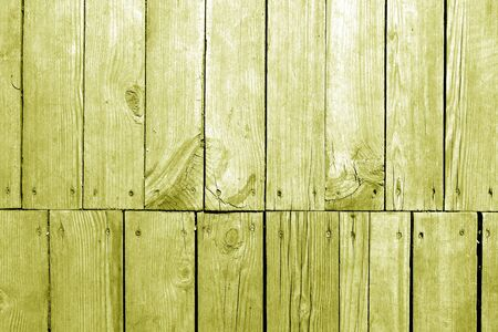 Old grungy wooden planks background in yellow tone. Abstract background and texture for design.