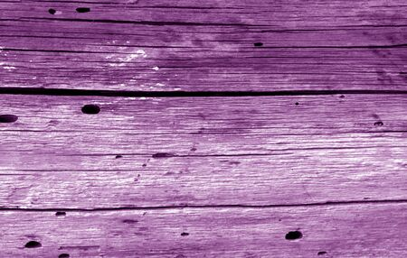 Old grunge wooden fence pattern in purple color. Abstract background and texture for design.