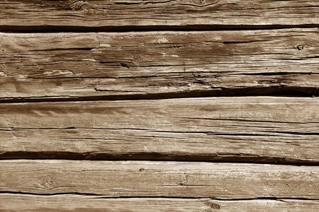 Old wooden wall in brown color. Abstract background and texture for design.