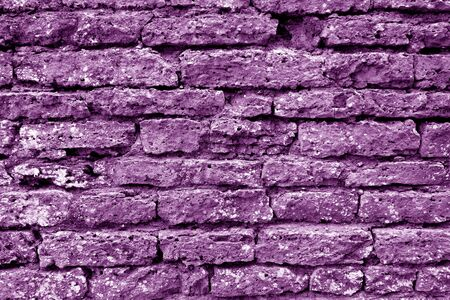 Old grungy brick wall texture in purple tone. Abstract architectural background and texture for design. 写真素材