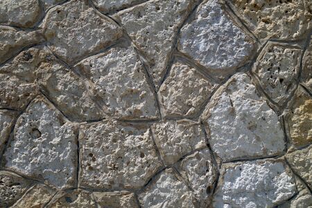 Wall made of old stones. Abstract background and texture for design. 写真素材