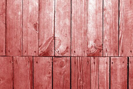 Old grungy wooden planks background in red tone. Abstract background and texture for design. Banco de Imagens