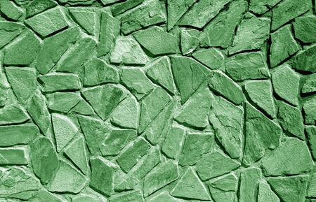 Wall made of old stones in green tone. Abstract background and texture for design. 写真素材