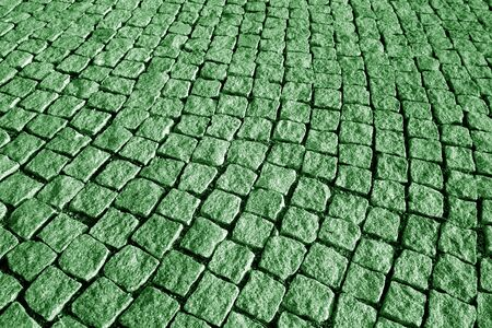 Stone pavement texture in green tone. Abstract background and texture for design.