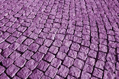 Stone pavement texture in purple tone. Abstract background and texture for design.