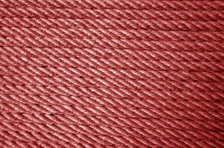 Jute rope pattern in red color. Abstract background and texture for design.