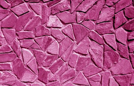 Wall made of old stones in pink tone. Abstract background and texture for design.