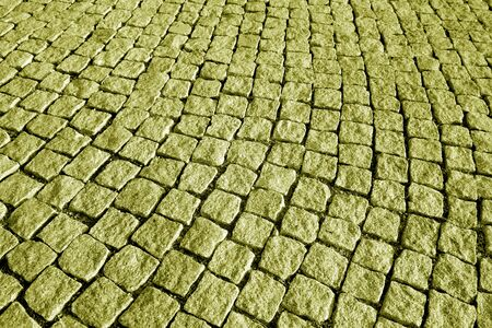 Stone pavement texture in yellow tone. Abstract background and texture for design.