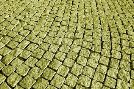 Textura de pavimento de piedra en tono amarillo. Fondo abstracto y textura para el diseño.