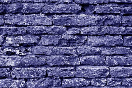 Old grungy brick wall texture in blue tone. Abstract architectural background and texture for design. 写真素材