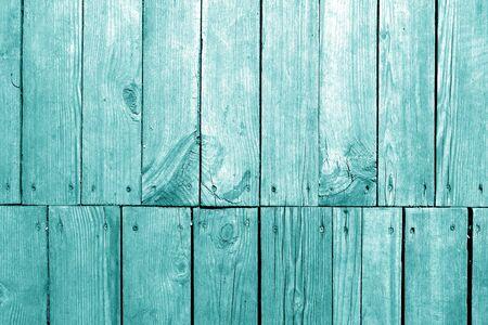 Oude grungy houten plankenachtergrond in cyaantint. Abstracte achtergrond en textuur voor ontwerp.