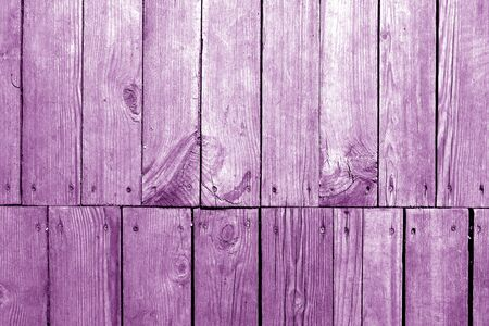 Old grungy wooden planks background in purple tone. Abstract background and texture for design.