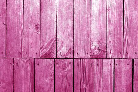 Old grungy wooden planks background in pink tone. Abstract background and texture for design.