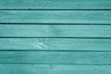 Old grungy wooden planks background in cyan color. Abstract background and texture for design. Banco de Imagens
