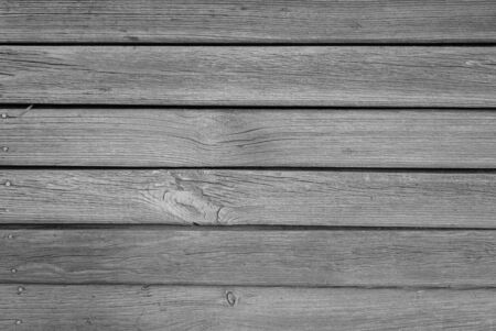 Old grungy wooden planks background in black and white. Abstract background and texture for design.