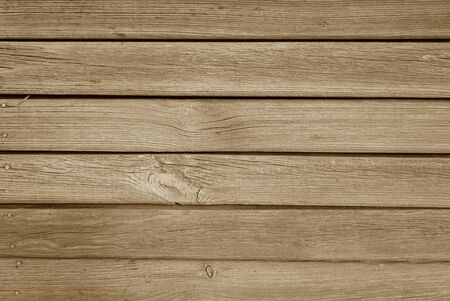Old grungy wooden planks background in brown color. Abstract background and texture for design.