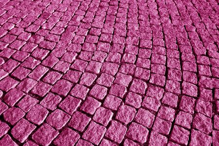 Stone pavement texture in pink tone. Abstract background and texture for design.