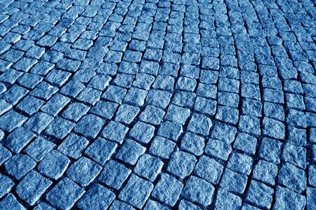 Stone pavement texture in navy blue tone. Abstract background and texture for design.