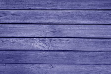 Old grungy wooden planks background in blue color. Abstract background and texture for design.