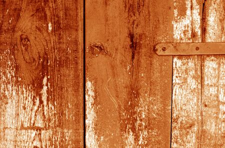 Grungy wooden planks background in orange color. Abstract background and texture for design.