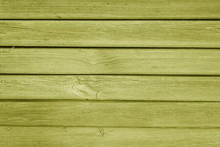 Old grungy wooden planks background in yellow color. Abstract background and texture for design.