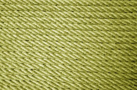 Jute rope pattern in yellow color. Abstract background and texture for design.