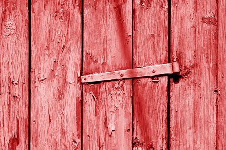 Grungy wooden planks background in red tone. Abstract background and texture for design.