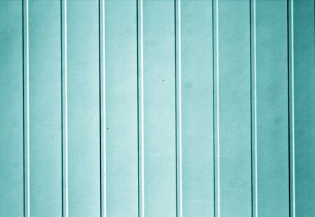 Plastic siding surface in cyan tone. Abstract background and texture.