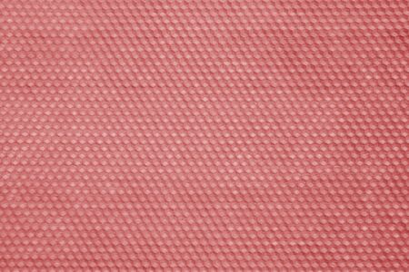 Honeycomb wax texture in red tone. Abstract background and texture.