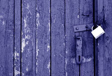 Grungy wooden door with lock in blue tone. Abstract architectural background and texture for design. Stock fotó