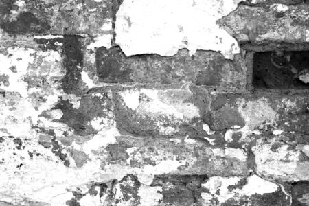 Old grungy brick wall texture in black and white. Abstract architectural background and texture for design. Stock fotó