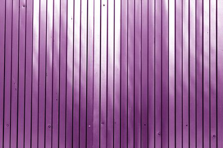 Metal list wall texture of fence in purple color. Abstract background and texture for design.