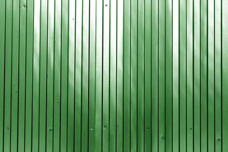 Metal list wall texture of fence in green color. Abstract background and texture for design.