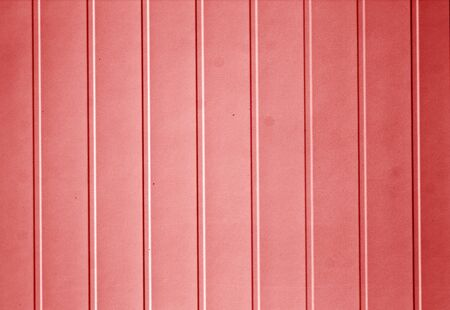 Plastic siding surface in red tone. Abstract background and texture.