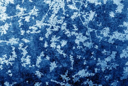 Abstract frost pattern on glass in navy blue tone. Abstract background and texture for design. Stock fotó