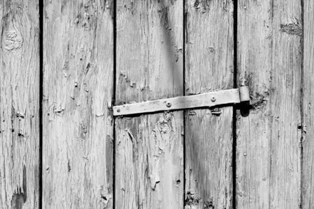 Grungy wooden planks background in black and white. Abstract background and texture for design.