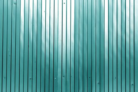 Metal list wall texture of fence in cyan color. Abstract background and texture for design.