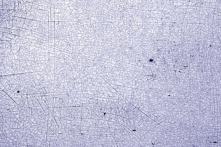 Cracks on metal texture in blue tone. Abstract background and texture for design.