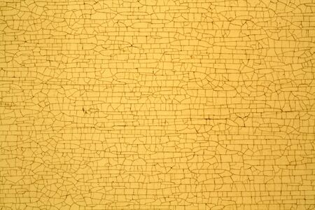 Yellow color cracks on metal texture. Abstract background and texture for design.