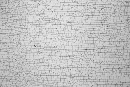 Cracks on metal texture in black and white. Abstract background and texture for design. Zdjęcie Seryjne