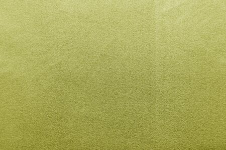Plastic glittering texture in yellow color. Abstract architectural background and texture for design.
