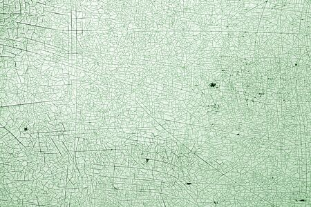 Cracks on metal texture in green tone. Abstract background and texture for design.
