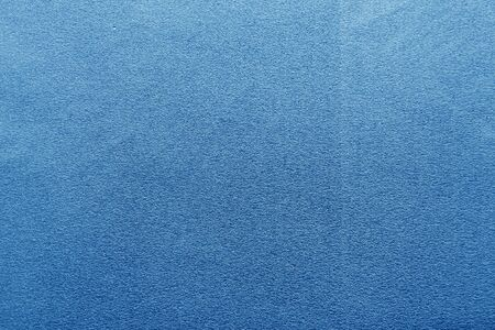Plastic glittering texture in navy blue color. Abstract architectural background and texture for design.
