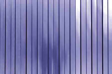 Metal list wall texture of fence in blue tone. Abstract background and texture for design.