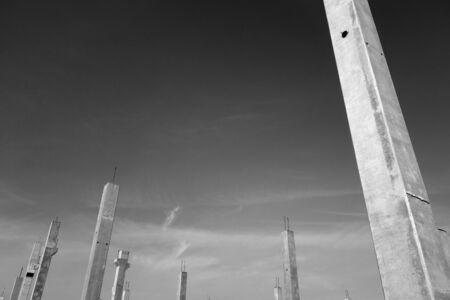 Concrete construction posts in black and white. Architectural background