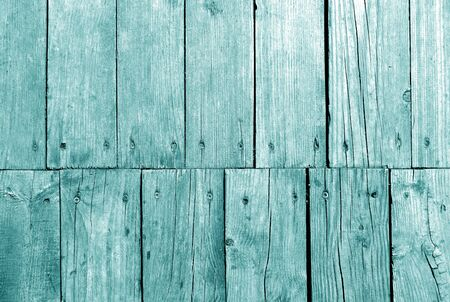 Old grungy wooden planks background in cyan color. Abstract background and texture for design.