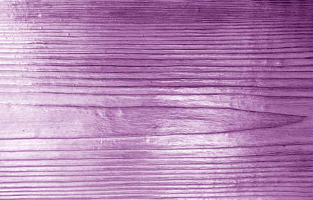 Wooden board texture with blur effect in purple tone. Abstract background and texture for design.