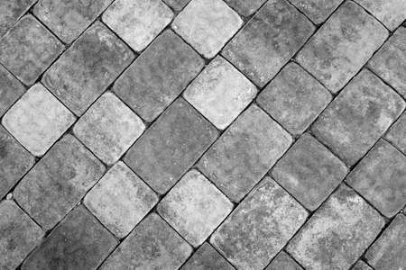 Stone pavement texture in black and white. Abstract background and texture for design.