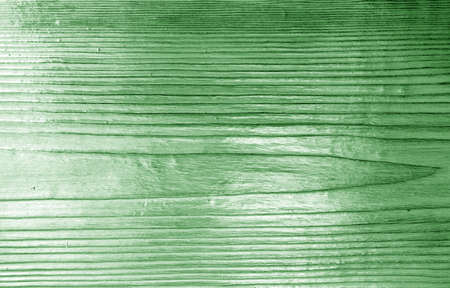 Wooden board texture with blur effect in green tone. Abstract background and texture for design.